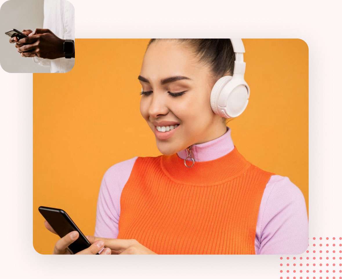 Woman looking at her phone with headphones on with person holding phone in top left corner